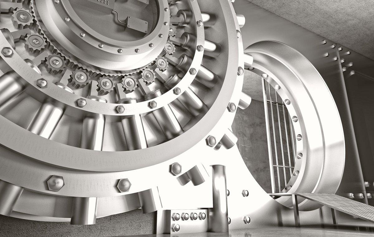Metal bank vault door, open and showing inside.