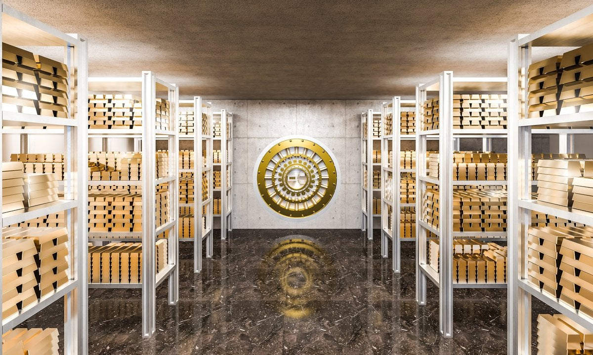 A bank vault filled with gold bars.