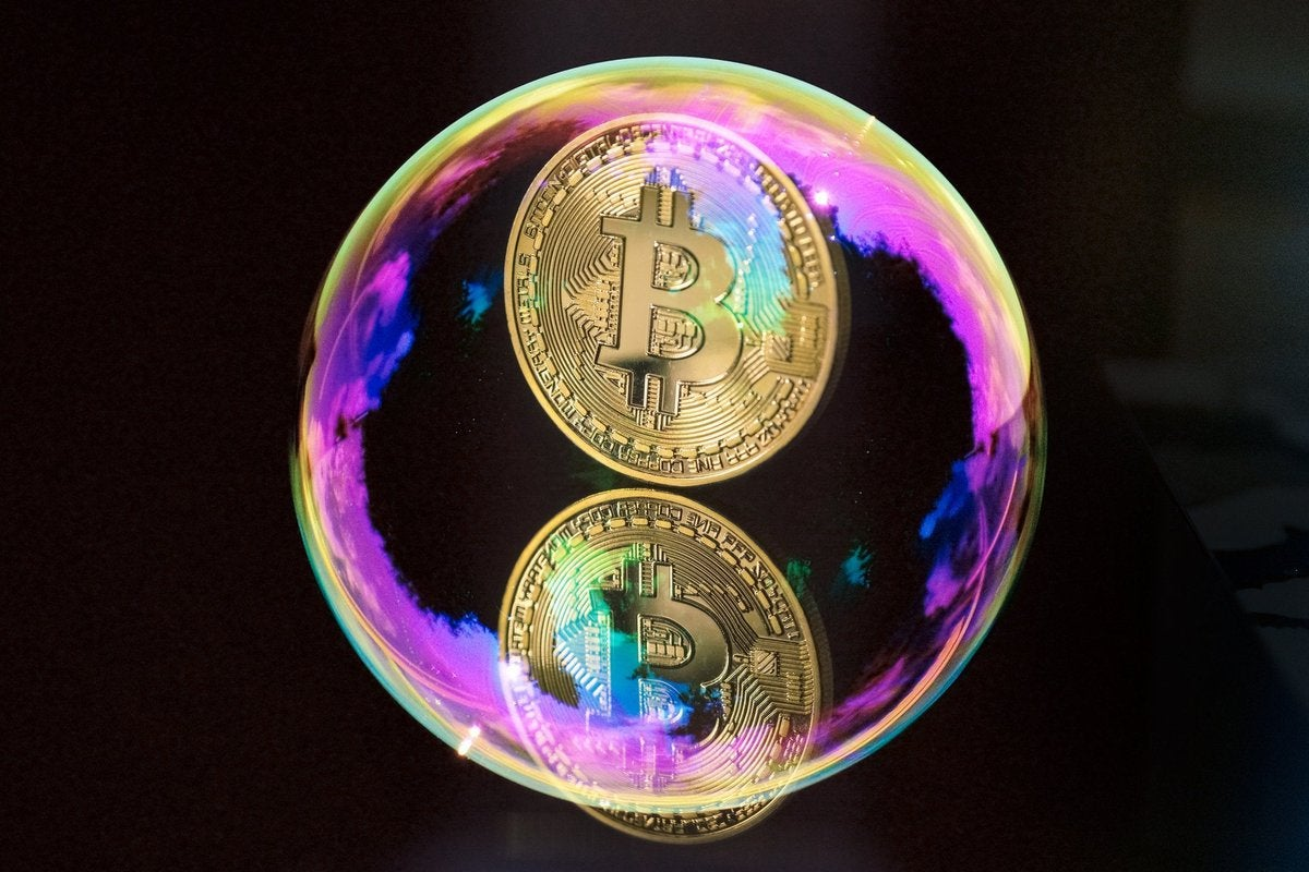 A coin with the Bitcoin B inside of a bubble.
