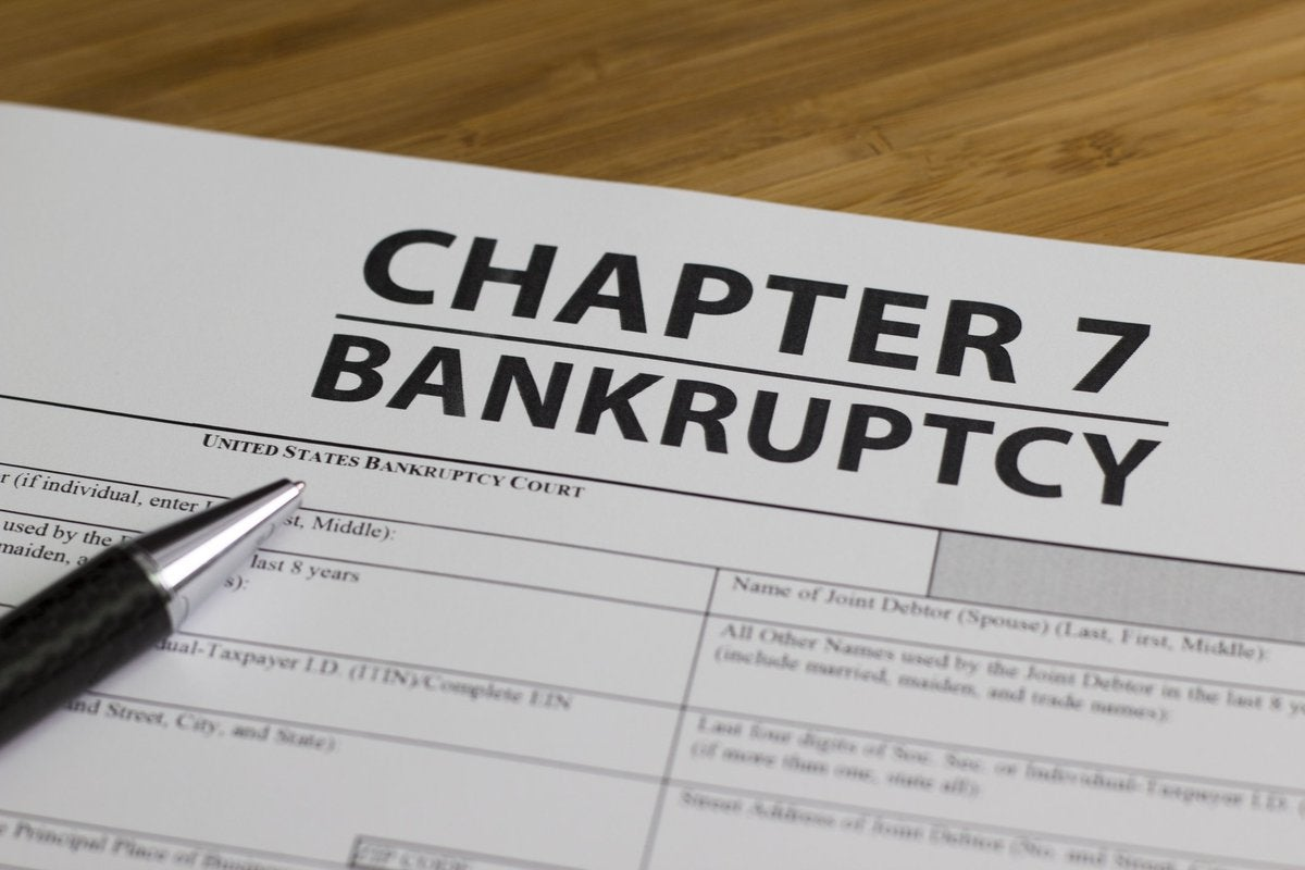 Chapter 7 bankruptcy form and pen.