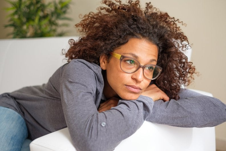 Concerned Young Woman In Glasses