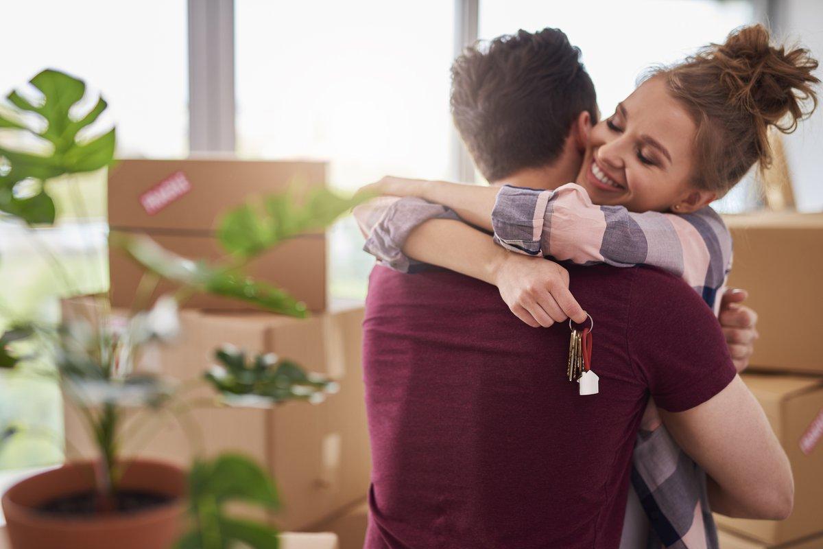 Couple Hugging With Keys.jpg