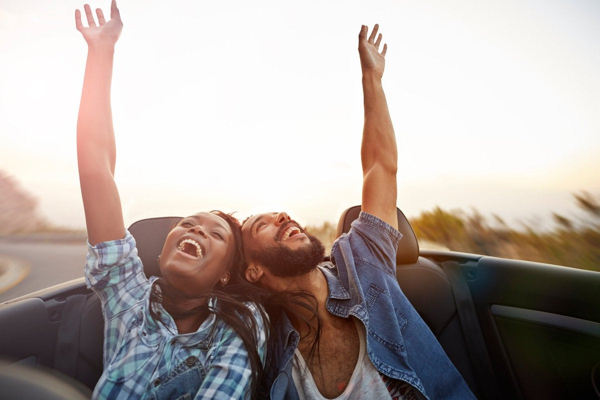 Young couple having fun together on a road trip.