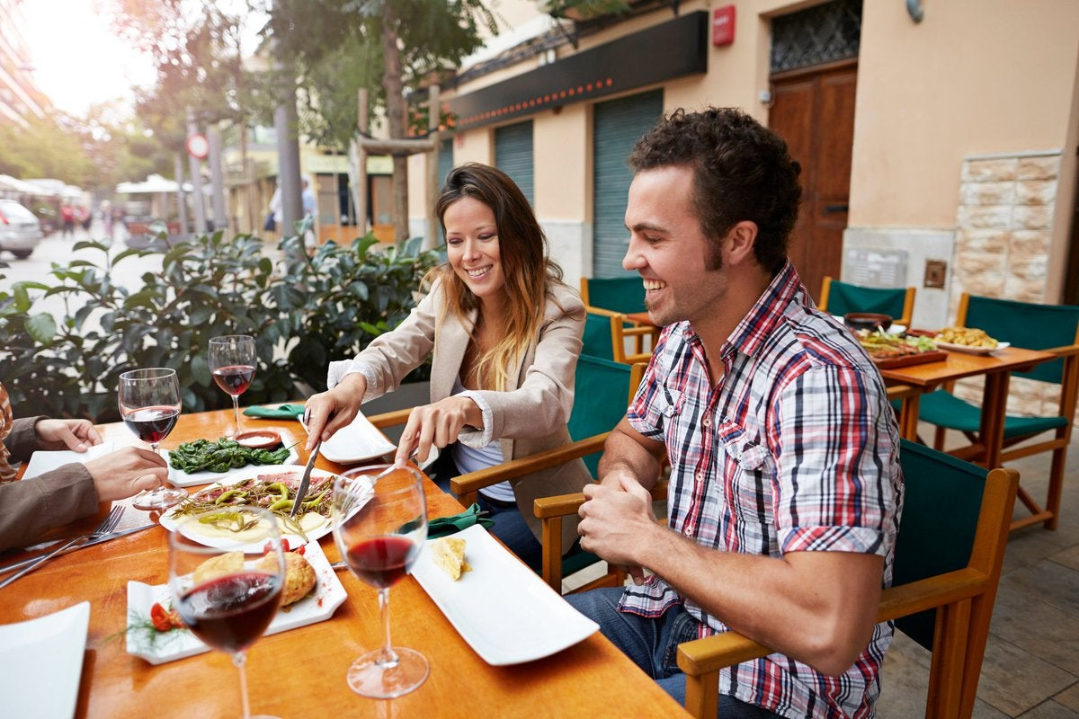 Couple sharing food at a european style restaurant