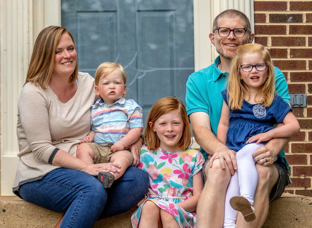 A Fair family portrait taken outdoors.