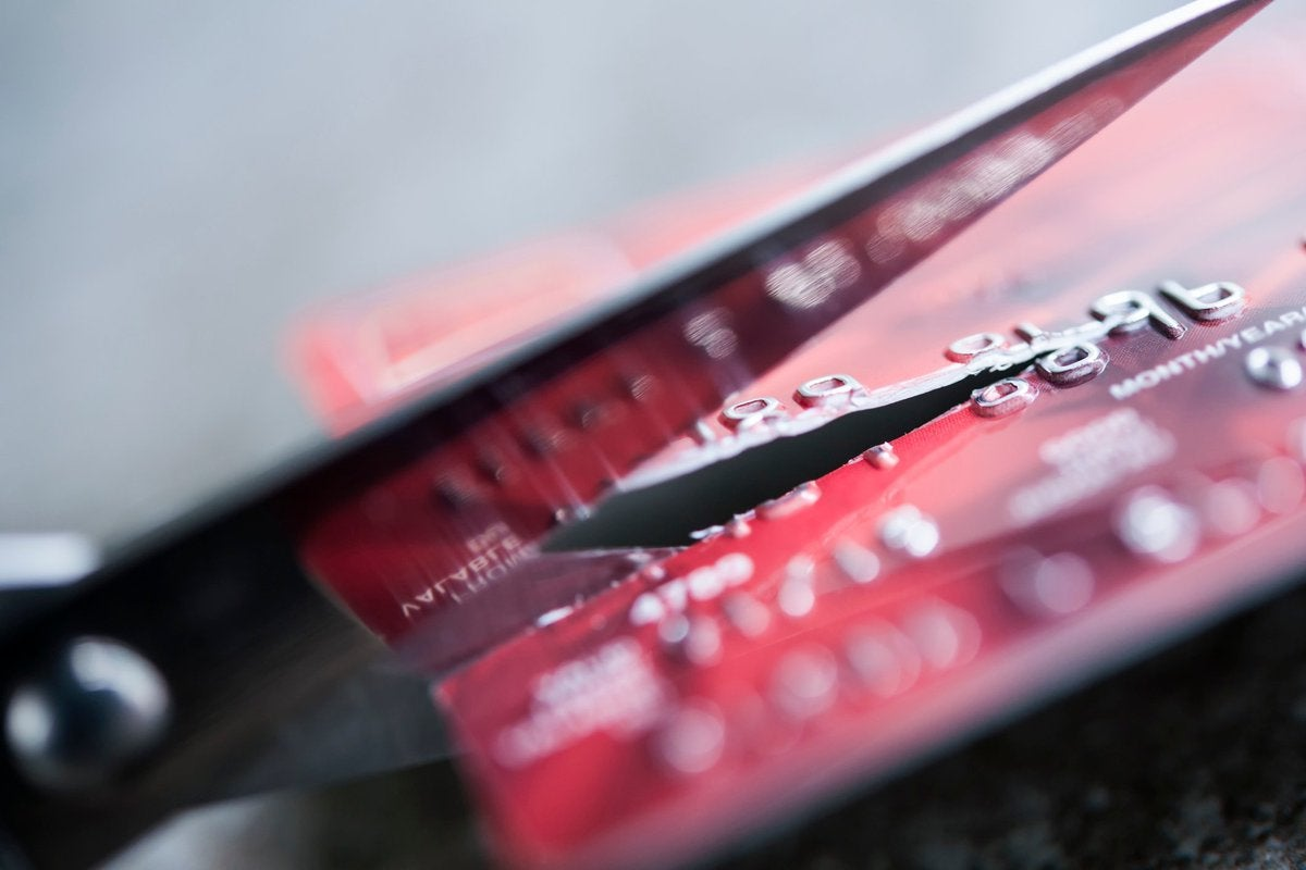 credit card being cut by a pair of scissors