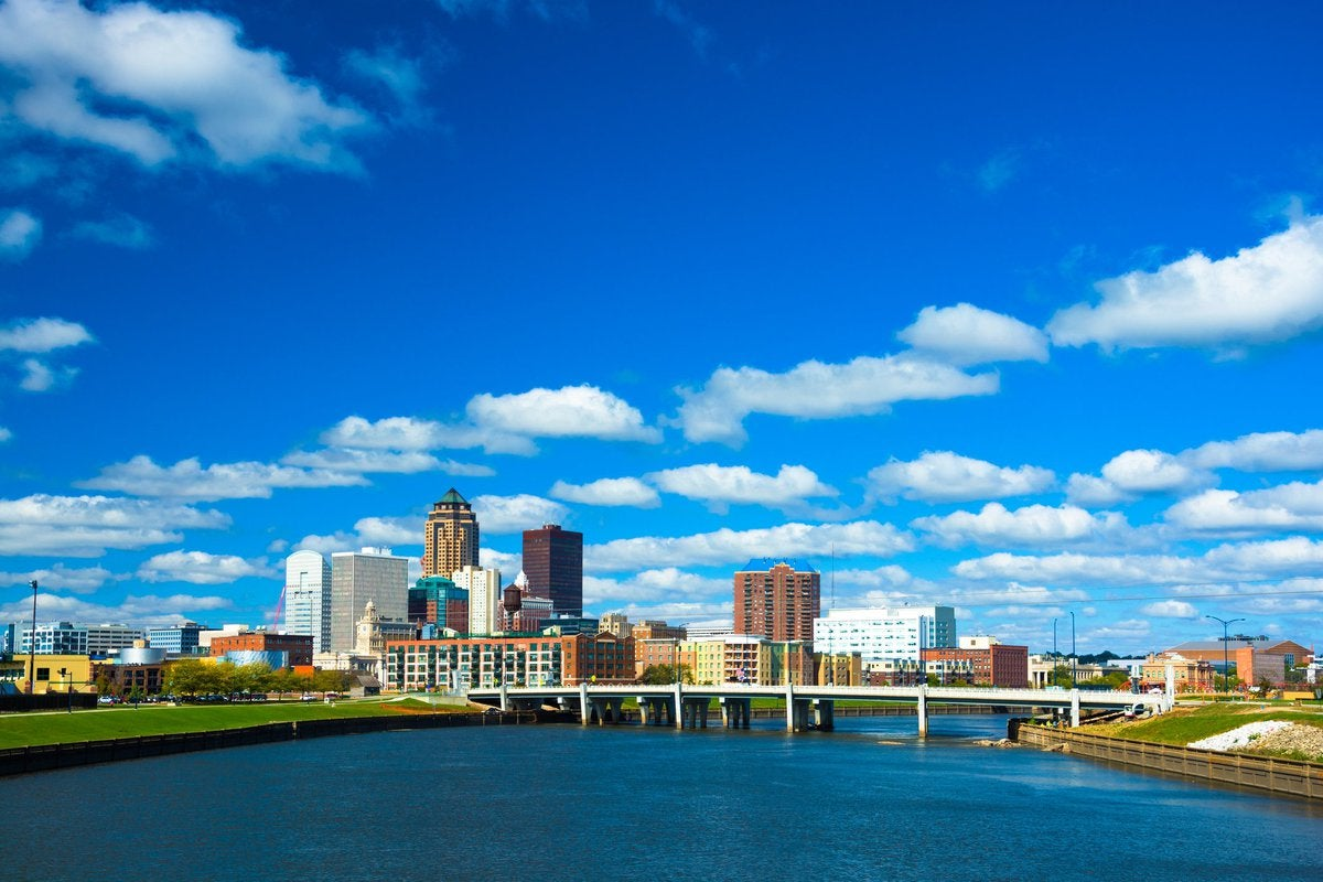 The Des Moines skyline seen from the river on a sunny day.