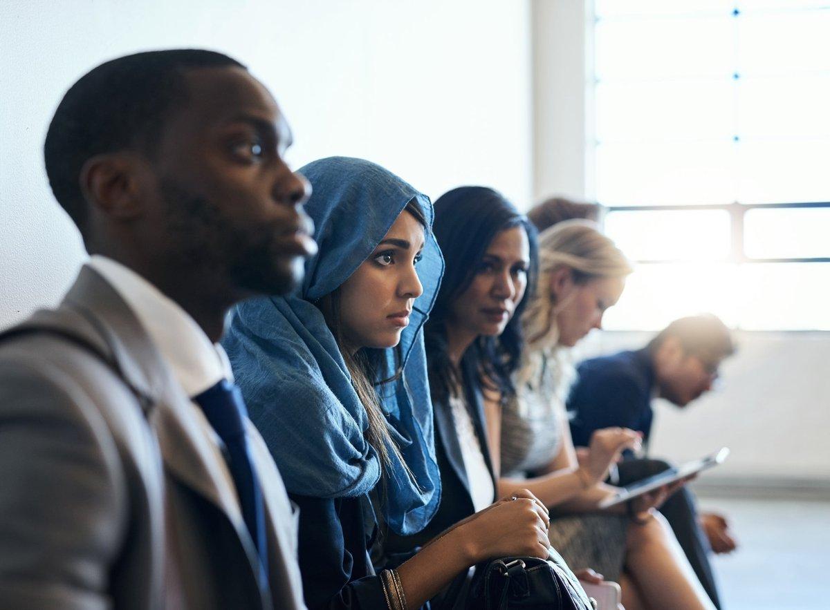 A diverse group of individuals awaiting job interviews.