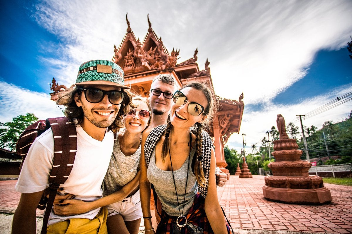 Four tourists in Thailand.