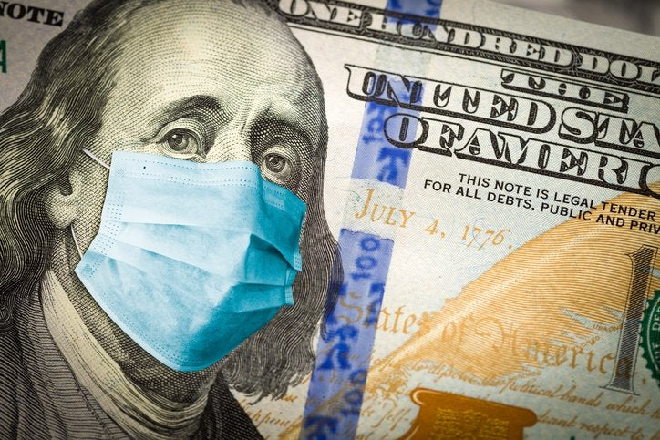 A 100-dollar bill with Ben Franklin wearing a medical mask