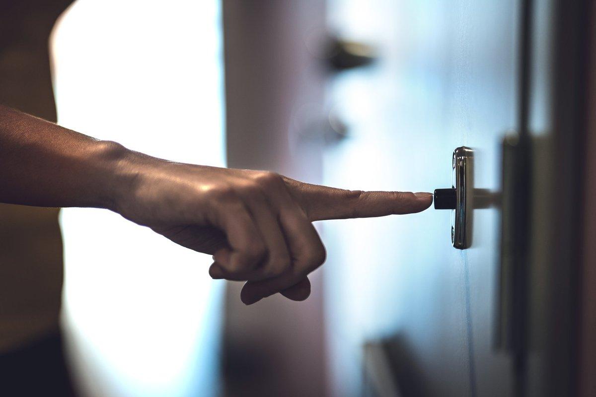 Finger ringing doorbell.