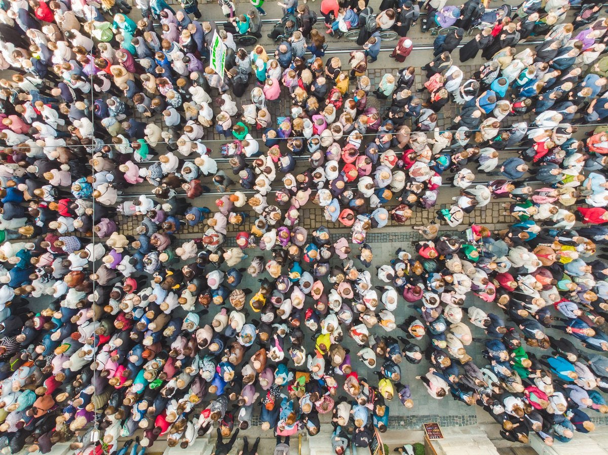 Overhead view of a massive gathering of people.