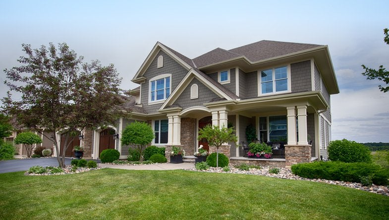 External view of a large grey suburban house.