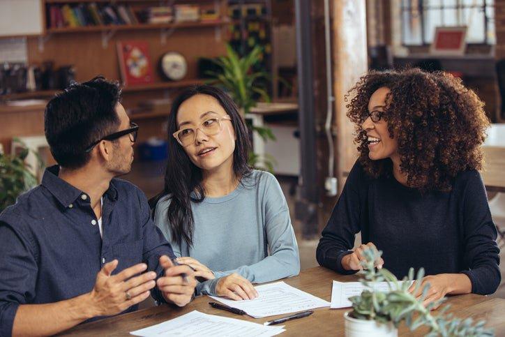 A couple receives financial advice from an associate.