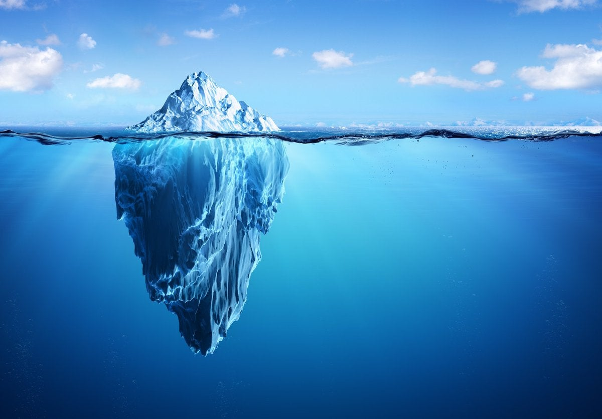Iceberg with small portion above the water and large portion below