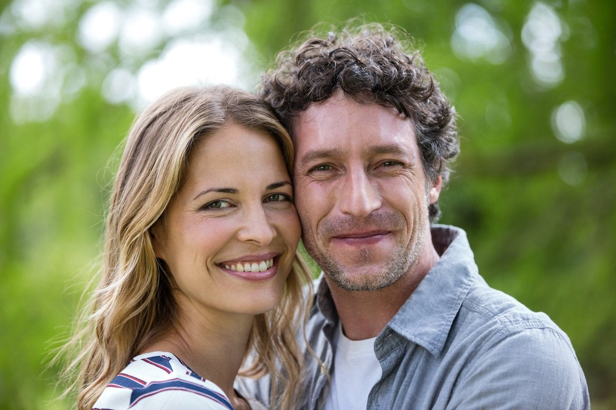 Smiling man and woman in their 40s