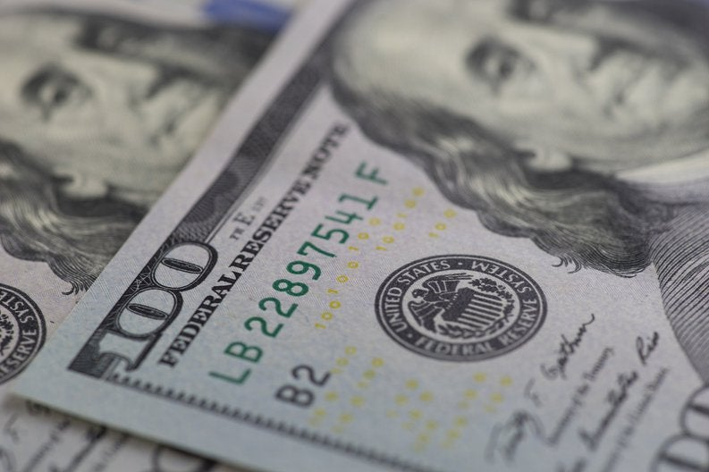 Close up image of two one hundred dollar bills.