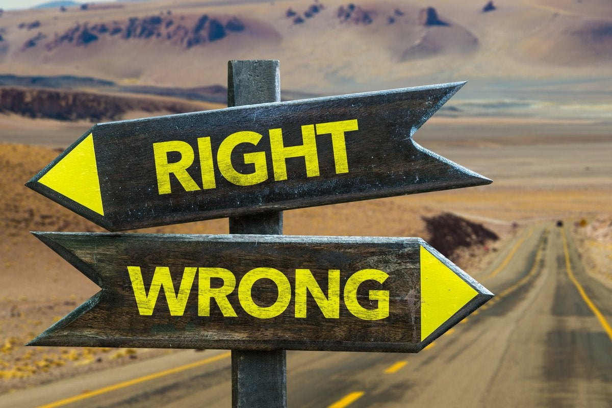 """two arrows on a road sign, one saying """"right"""" and the other saying """"wrong"""""""