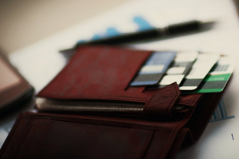Wallet sitting open showing credit cards