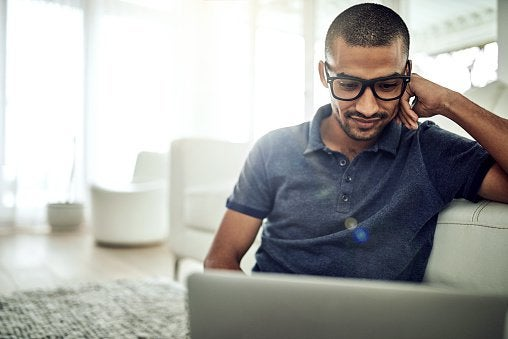 Guy With Glasses Looking At Laptop
