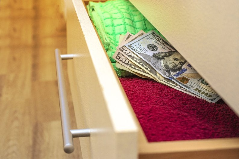 Money hidden in a dresser drawer.