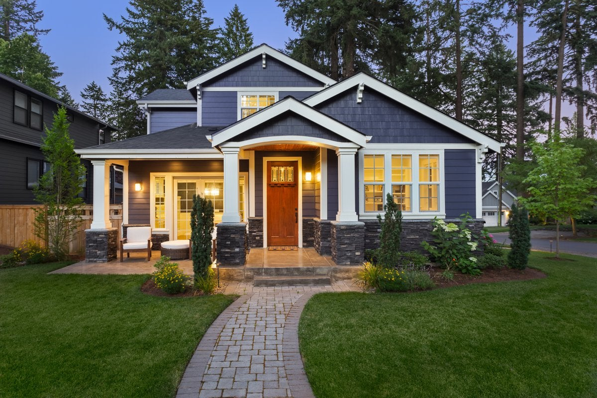 The exterior of a new home at twilight.