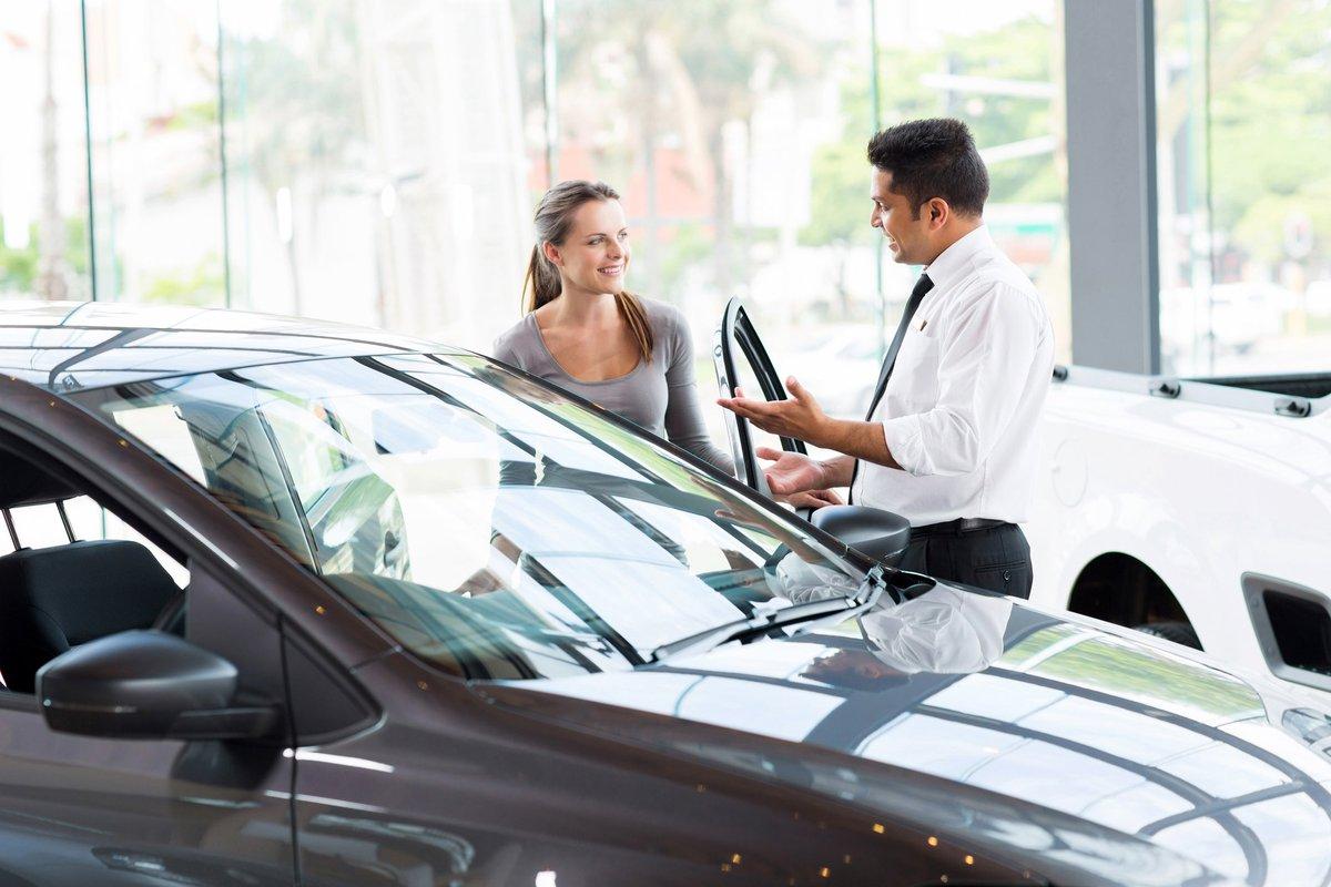 Dealer Showing Female Customer A Car