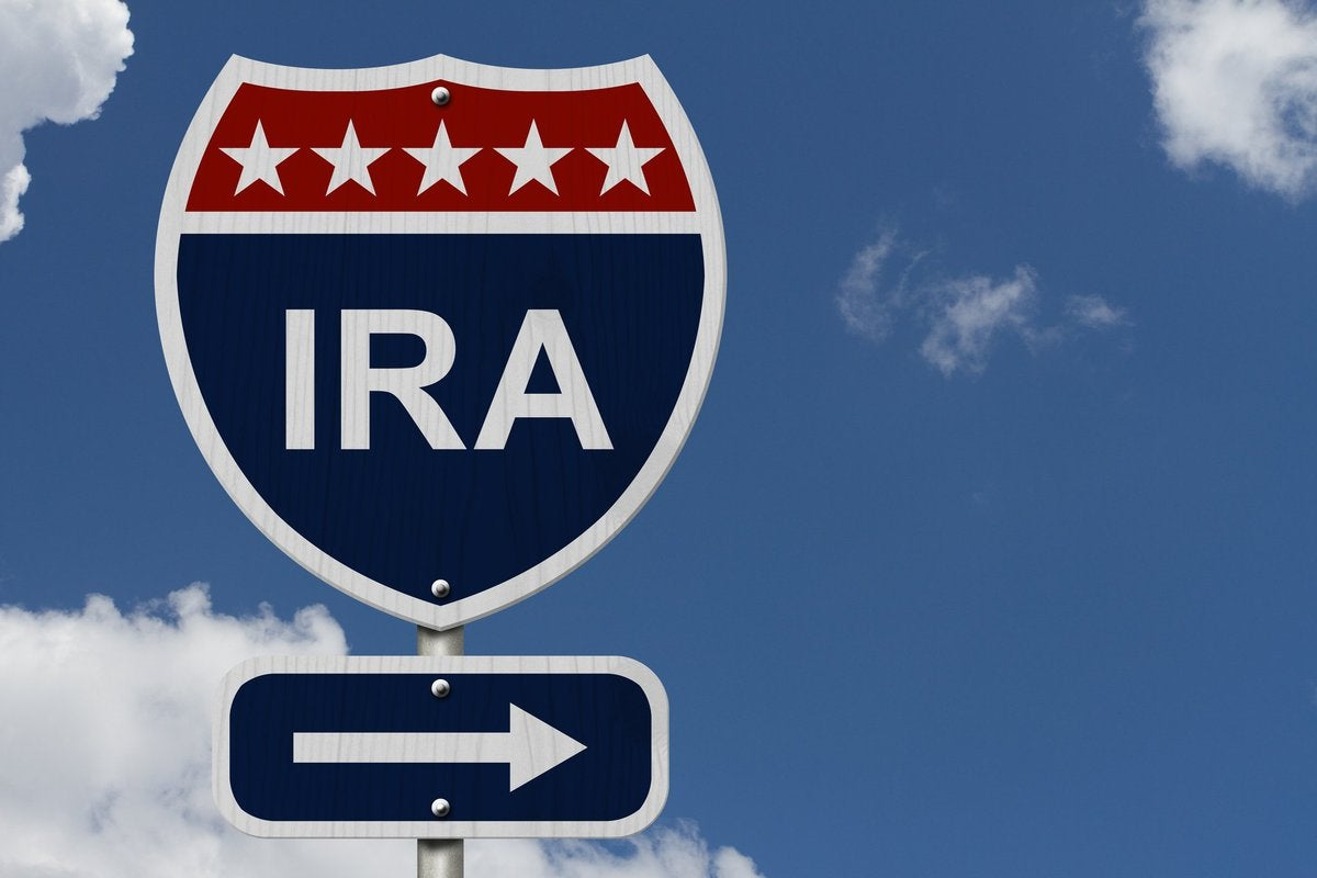 A street sign is labelled IRA with an arrow pointing right.