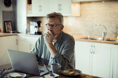 Man In Kitchen On Laptop