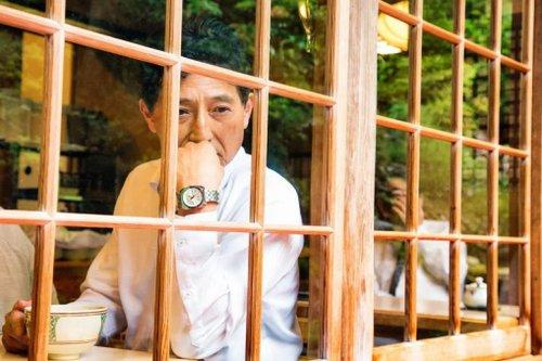 Man Looking Through Window