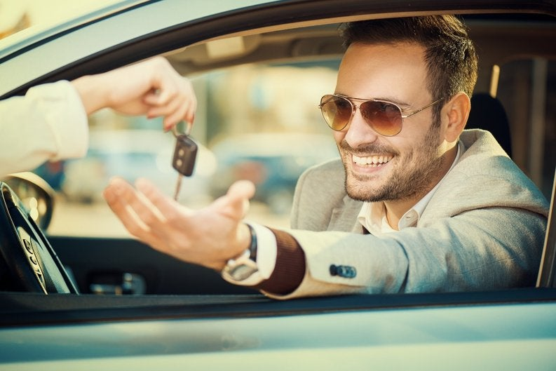 Man Taking Keys When Buying New Car