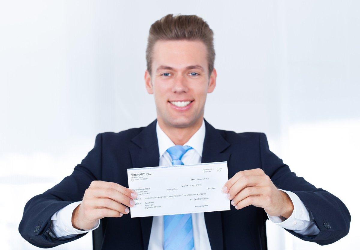 Man holding check