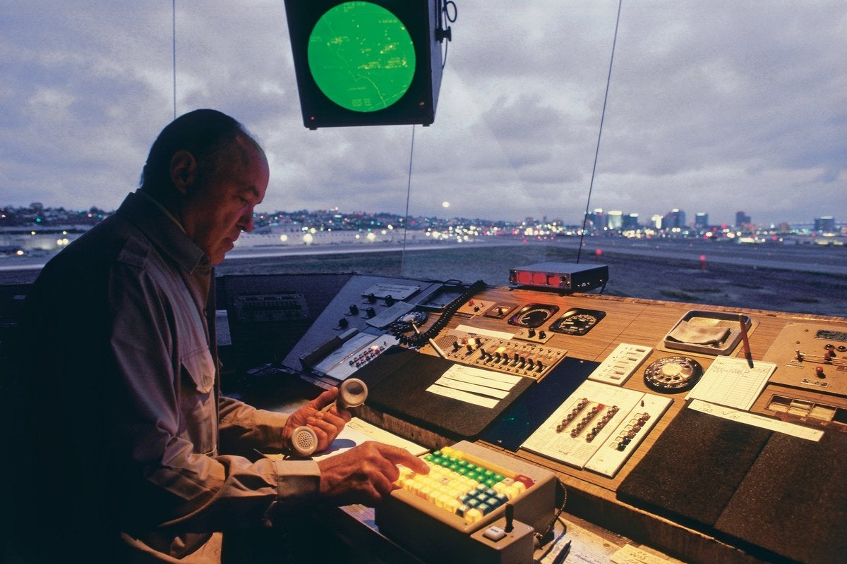 Man working in air traffic control tower.