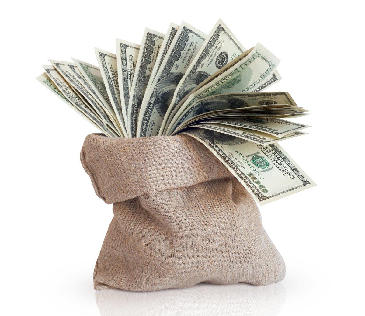 Burlap bag filled with hundred dollar bills.