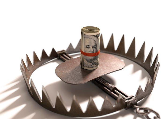 A roll of bills baits a trap.
