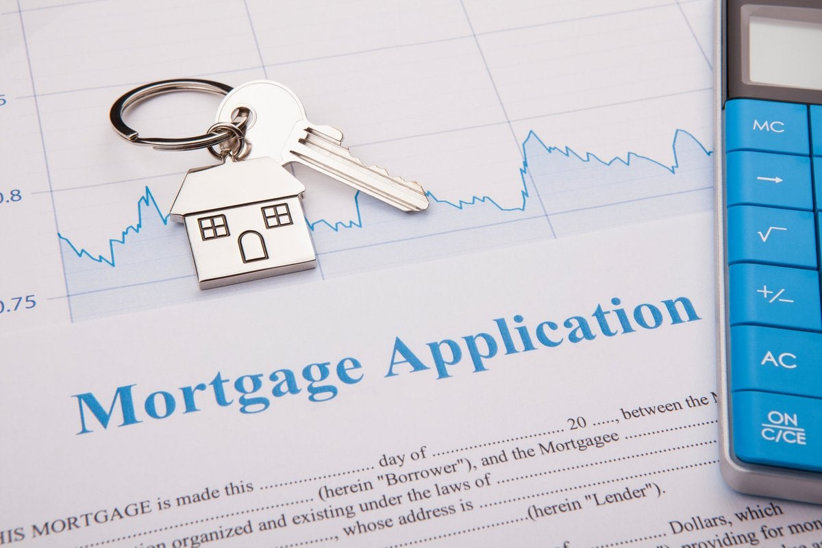 Key ring and calculator on top of paperwork for a mortgage application.