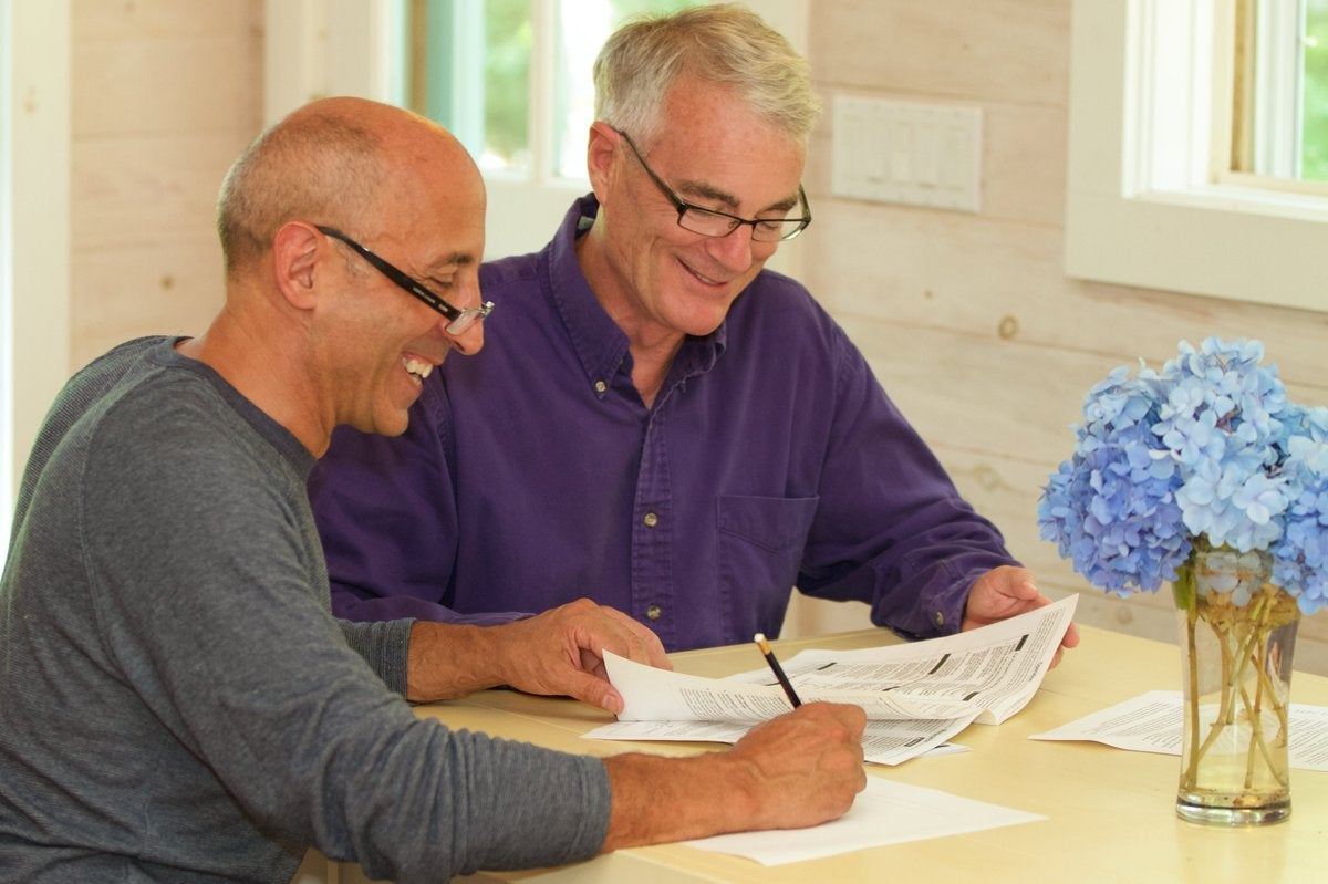 An older couple sit and go over their finances.