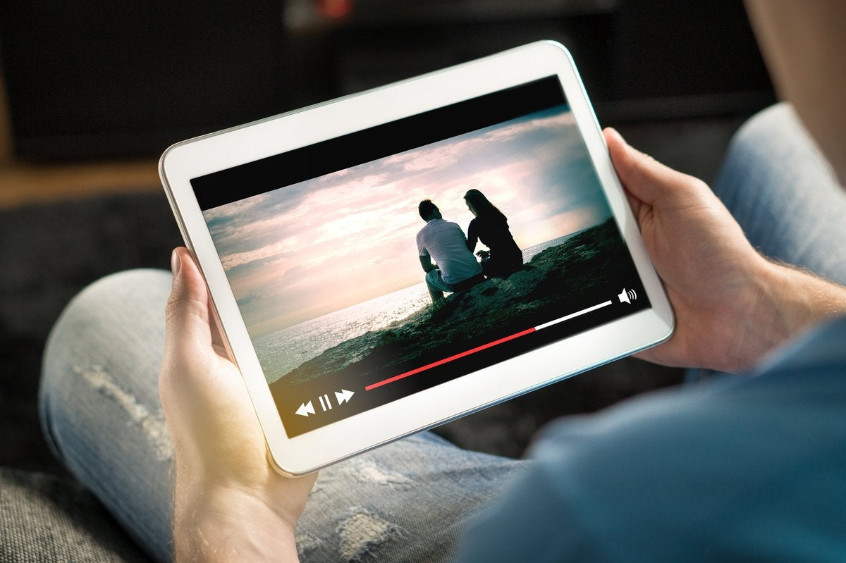 Person viewing a streaming service on a tablet.