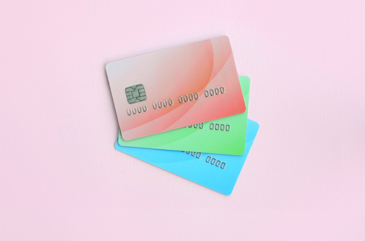 Pastel-colored credit cards on a pink background