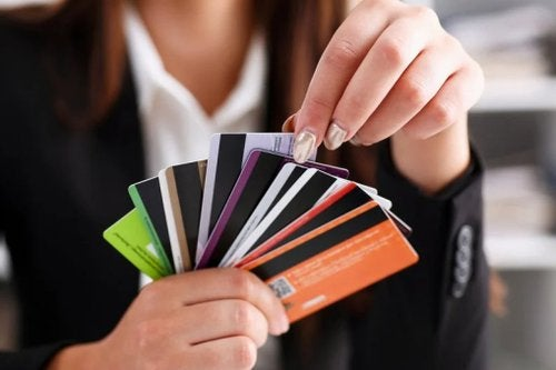 Person Holding Fan Of Credit Cards