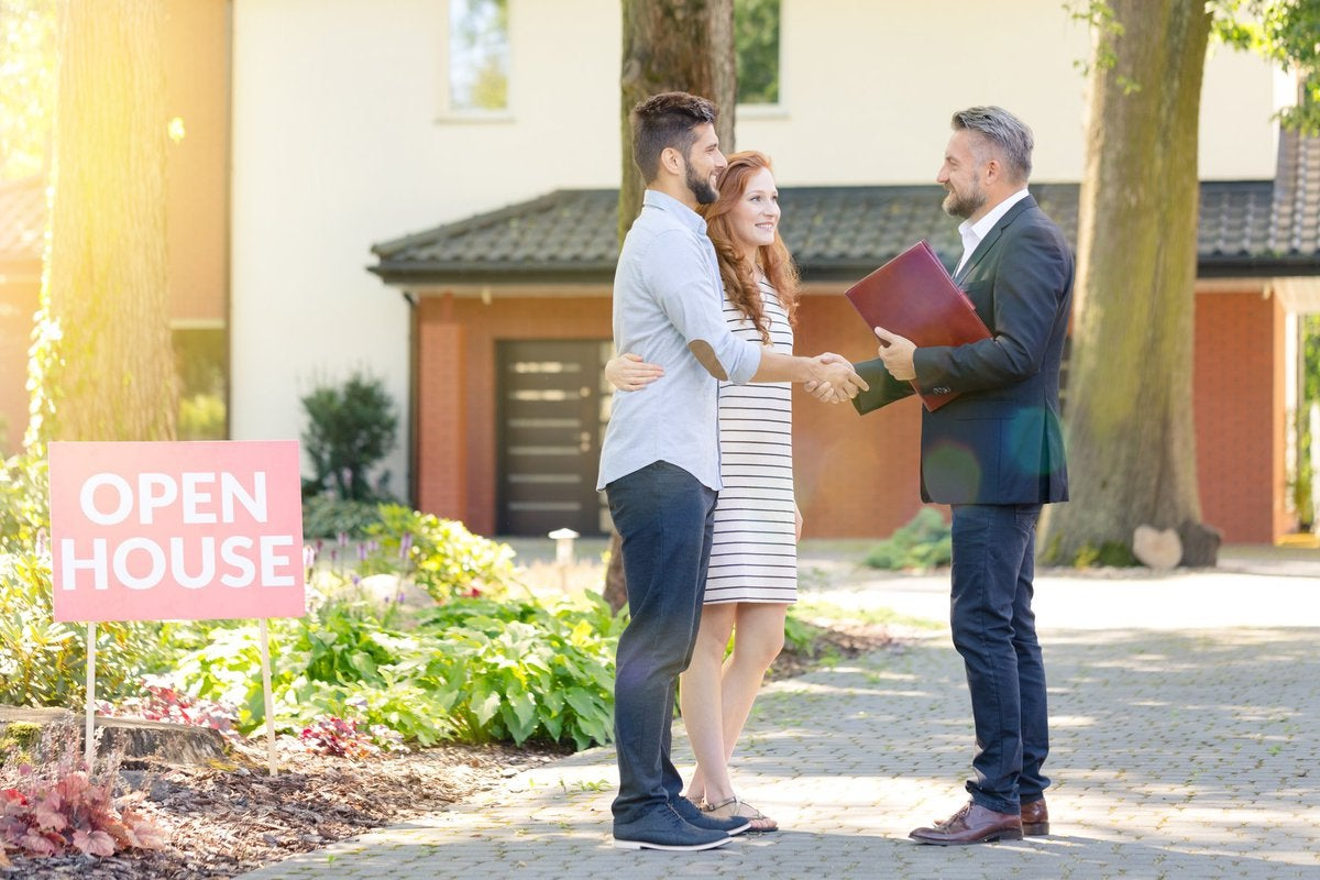 Couple meeting realtor at open house.