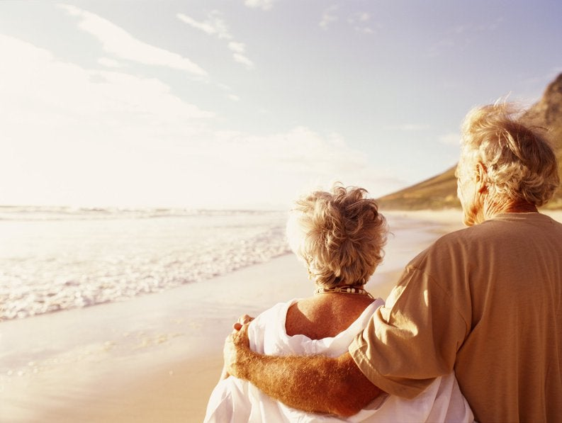 Senior couple standing on beach