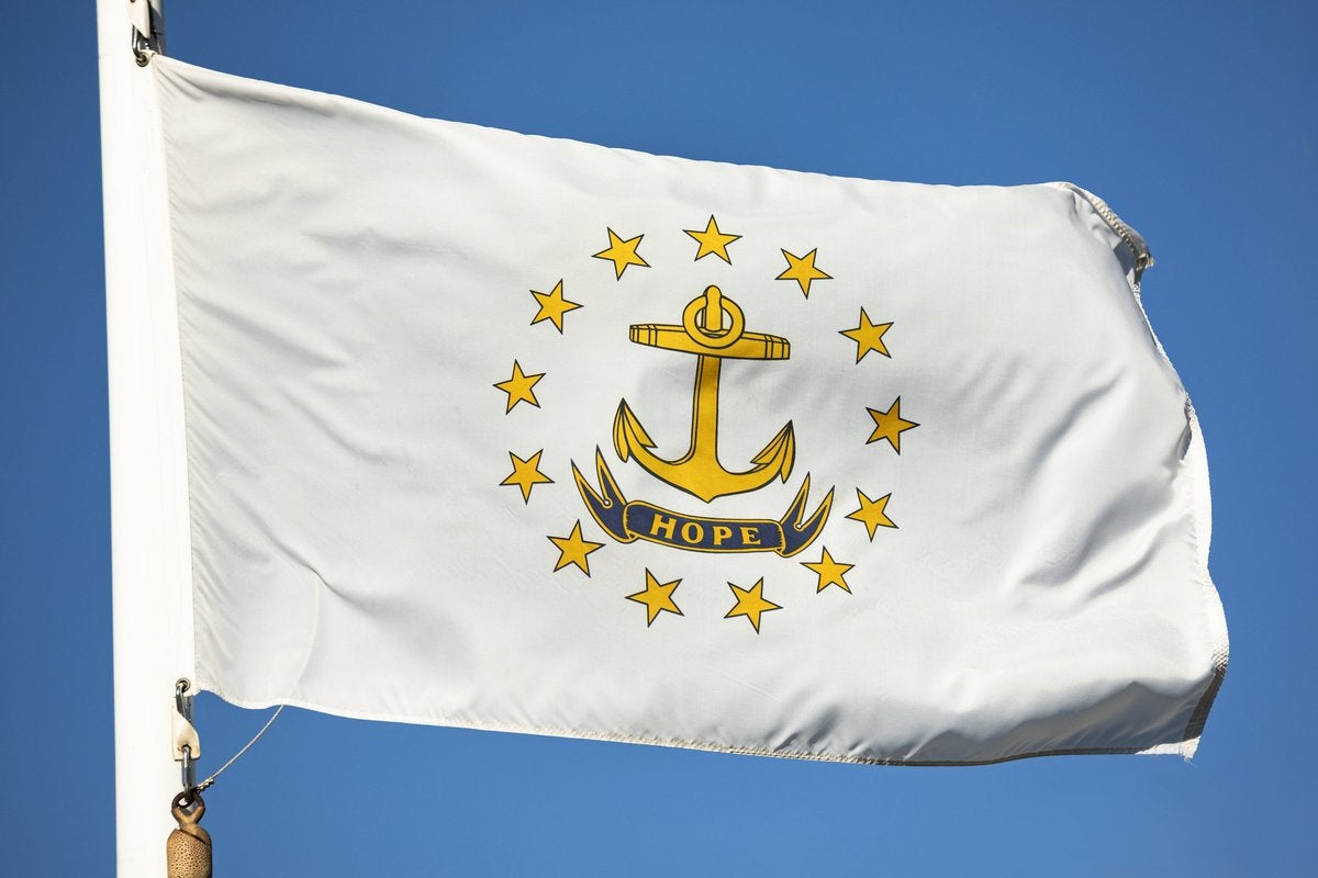 The Rhode Island state flag in front of a blue sky.