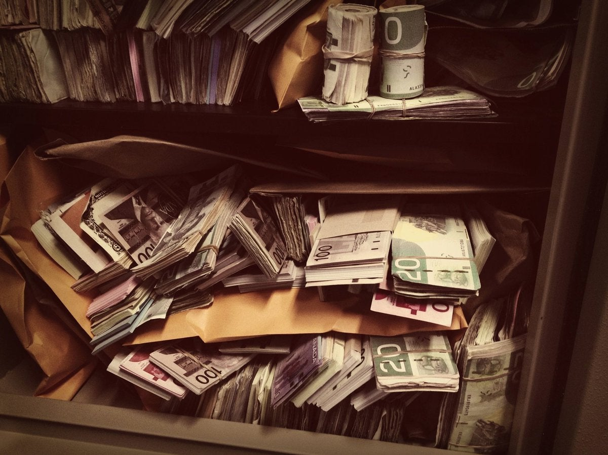 Vault filled with stacks and rolls of money.