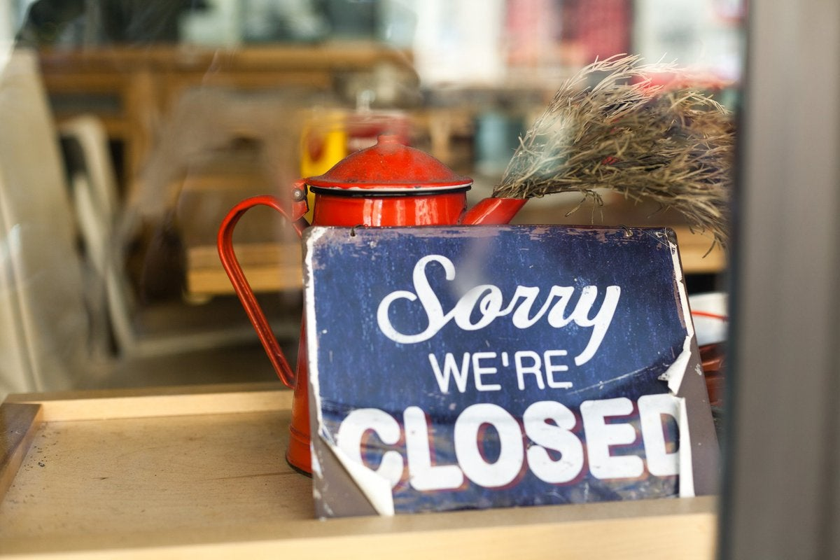 A shop window sign that says Sorry We're Closed