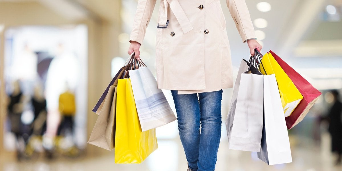 Woman Carrying Several Shopping Bags