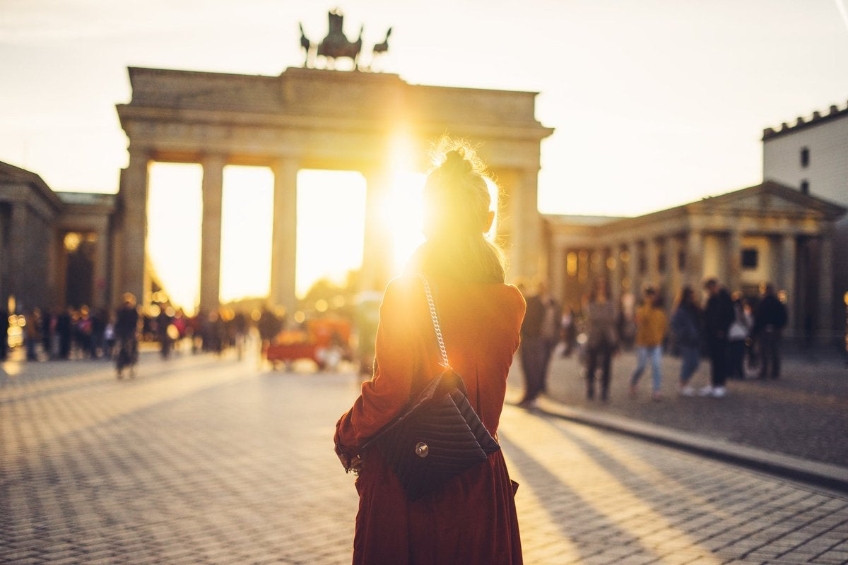 Silhouette of woman in front of German tourist site in Berlin.