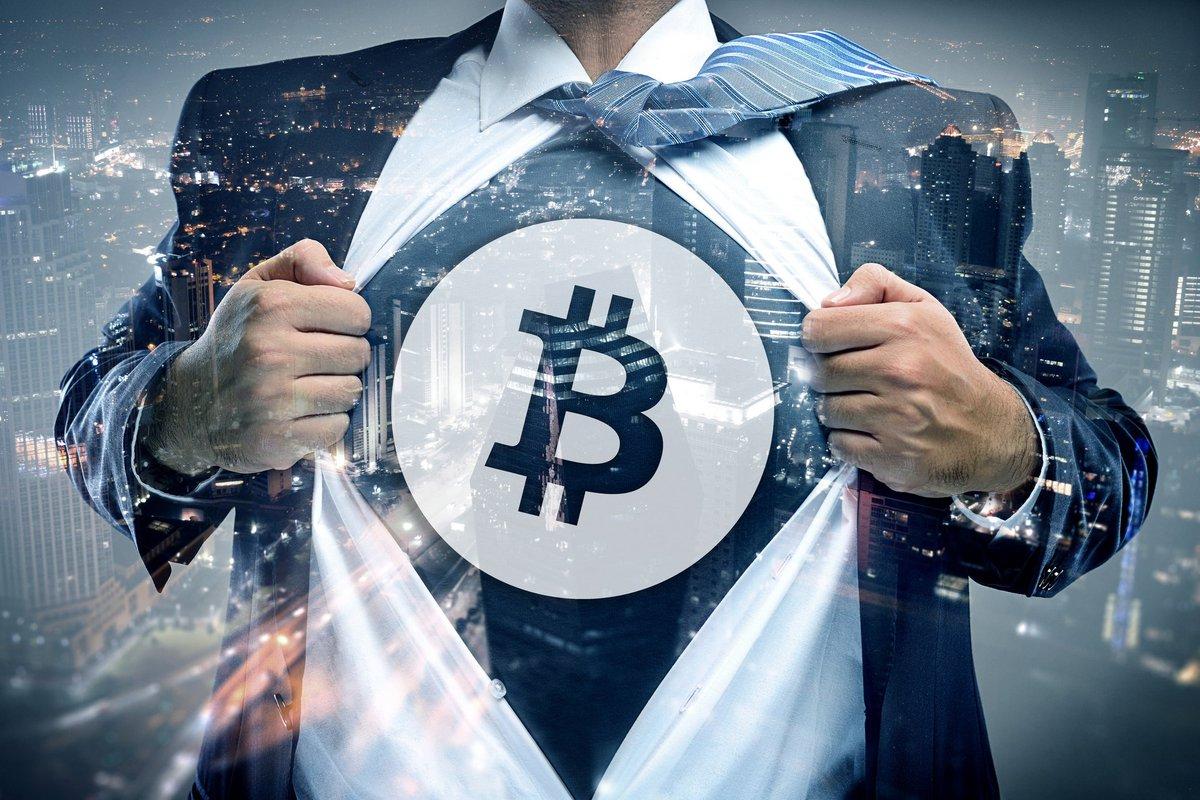 Bussinessman revealing Bitcoin symbol beneath suit