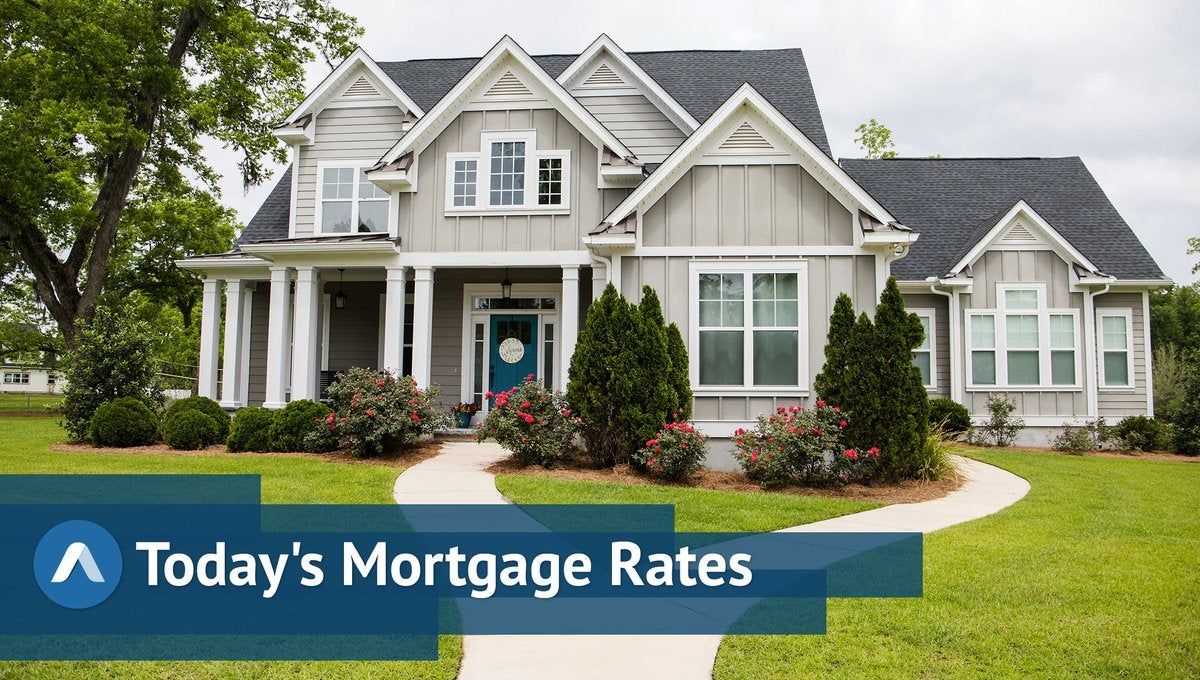 Large, fancy house with Daily Mortgage branding.