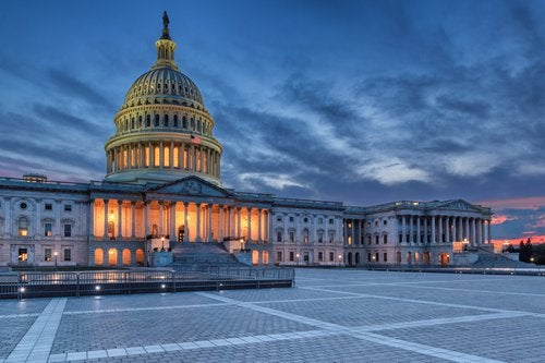 The United States Capitol building in Washington DC at twilight.